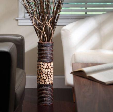 Напольная ваза с искусственными декоративными ветвями