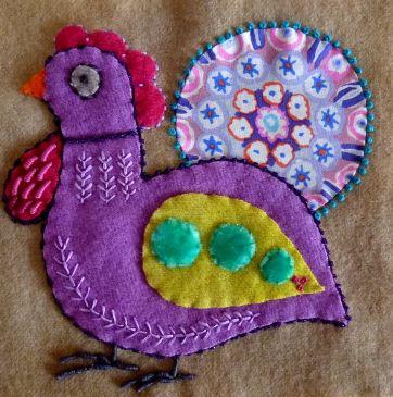 Птичка из лоскутков - образец предметной текстильной аппликации